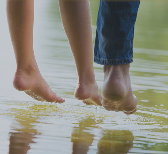 People put their feet in the water near their new home in Manvel, TX